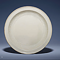 A rare moulded Ding dish, Yuan dynasty (1279-1368)