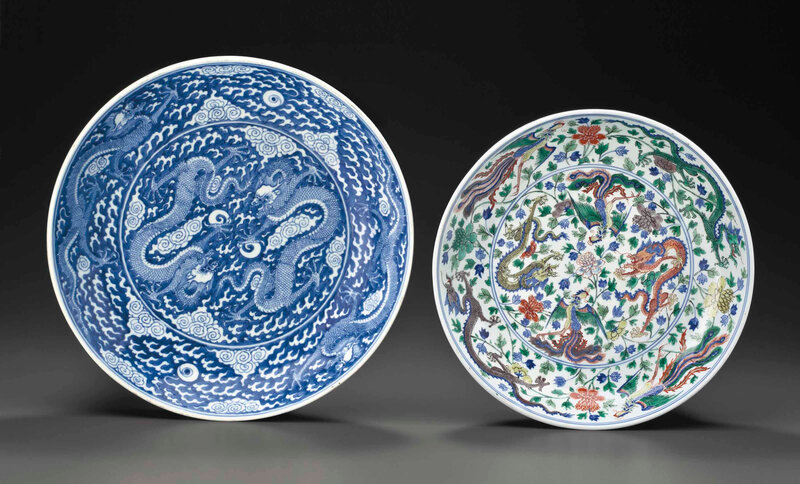 A large blue and white 'Dragon' dish and a largewucai'Dragon and Phoenix' dish, Kangxi six-character marks in underglaze blue within a double circle and of the period (1662-1722)