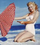 1949_tobey_beach_by_dedienes_umbrella_red_071_2