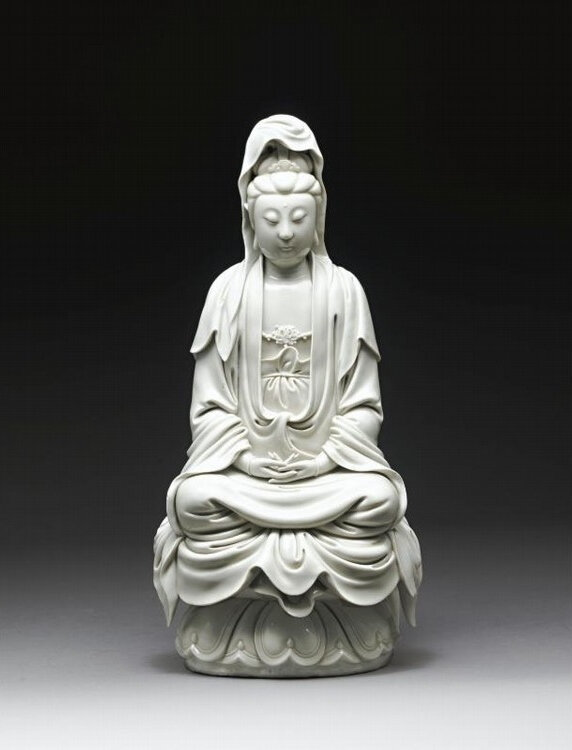 A rare and important 'blanc-de-chine' figure of Guanyin By He Chaozong