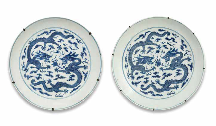 A pair of large blue and white 'dragon' dishes, Guangxu six-character marks and of the period (1875-1908)