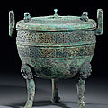 An inscribed archaic bronze tripod incense burner and cover, ding, eastern zhou dynasty
