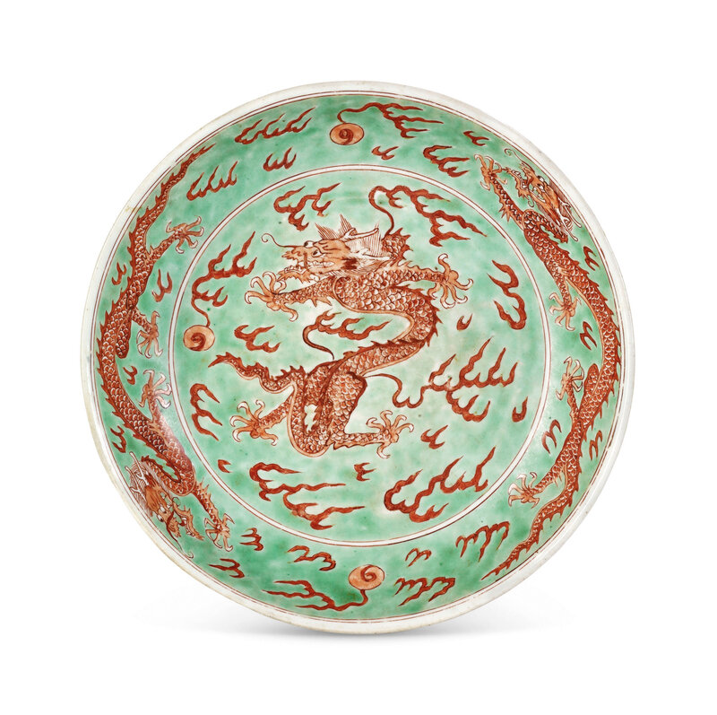 A green ground iron-red decorated 'Dragon' dish, Kangxi six-character mark in underglaze blue within a double circle and of the period (1662-1722)