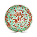 A green ground iron-red decorated 'dragon' dish, kangxi six-character mark in underglaze blue within a double circle and of the