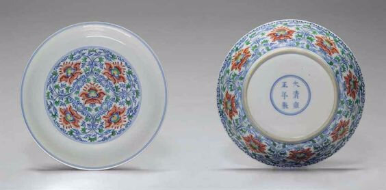 A rare pair of doucai 'Lotus' dishes, Yongzheng six-character mark within double-circles and of the period (1723-1735)