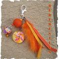 VENDU_bijou_de_sac_orange_encre_ruban_et_plume