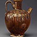 A dark amber-glazed ovoid ewer, liao dynasty, 10th century