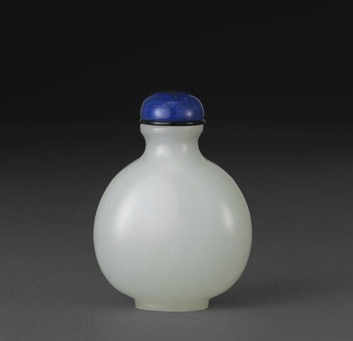 A white glass snuff bottle simulating jade, 1850-1950. Photo Bonhams