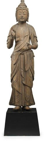 A standing wood figure of Kannon, Nanbokucho period (14th century)