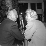 1954_Marilyn_Natural_011_Coat_inRacquetClub_withWPowell