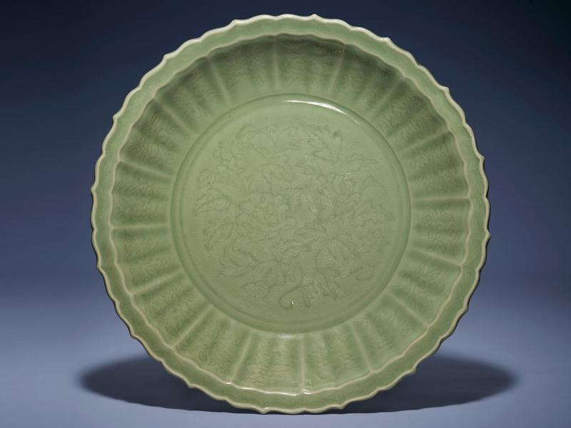 A large Longquan celadon 'peony' barbed-rim dish, Yongle period (1403-1425)