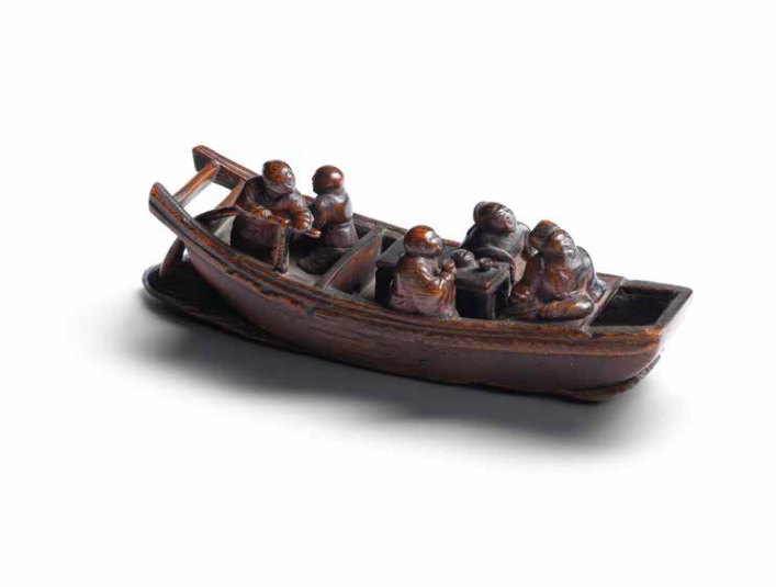 A very rare rhinoceros horn 'Ode to the Red Cliffs' carving of figures in a sampan, 17th-18th century