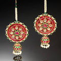 A indian pair of diamond-set and enamelled gold ear ornaments (karnaphul junka)