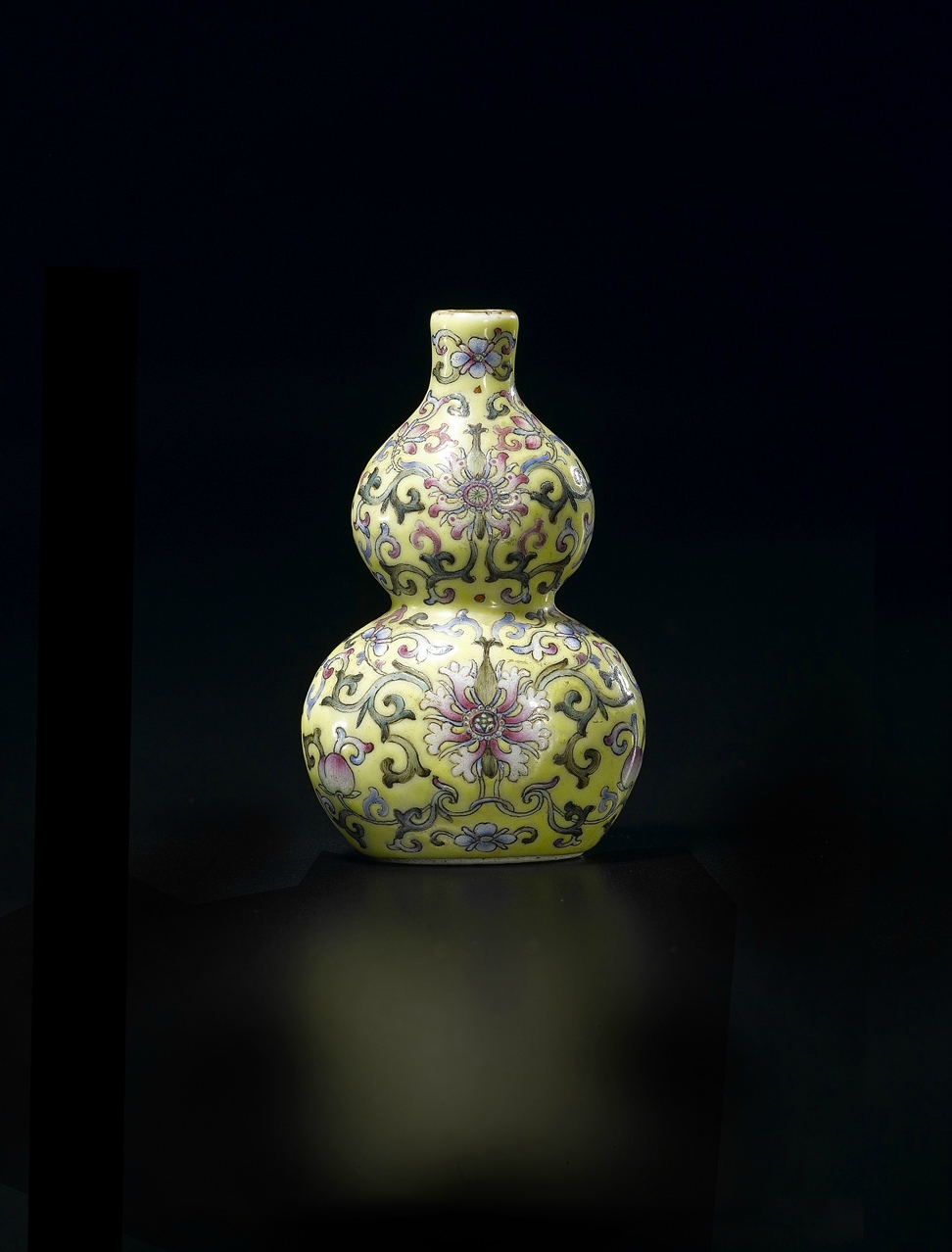 Fine Chinese Miniature Famille Rose Double Gourd Vase, Six character Jiaqing mark and of the period (1796-1820). Dimensions: (Height) 7.5 cm (3 in.). Provenance: Allan Gibson Hughes (d.1938), of Chalfont, The Mount, Shrewsbury. Photo courtesy Woolley & Wal