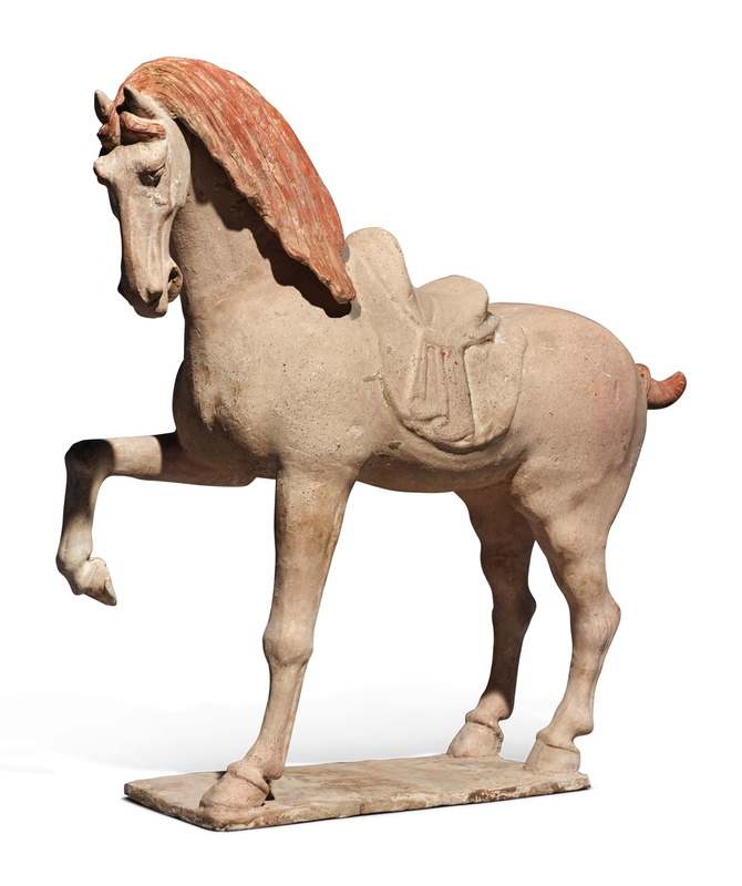A large painted pottery figure of a prancing horse, Tang dynasty (618-907)