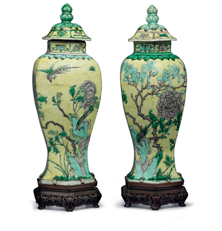 A pair of yellow-groundfamille vertehexagonal vases and covers, China, Kangxi period (1662-1722)