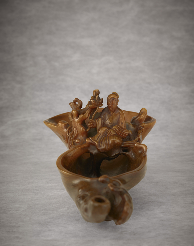 2011_HGK_02893_2913_001(a_very_rare_finely-carved_raft-form_rhinoceros_horn_pouring_waterdropp)