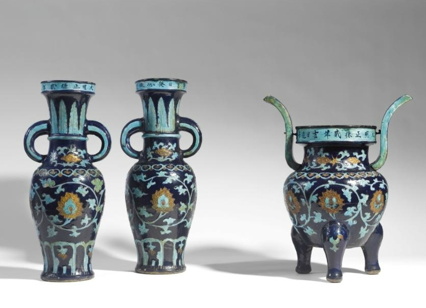 A rare dated 'Fahua' altar garniture, Zhengde mark and period (1506-1521)