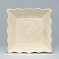 A small moulded white-glazed square dish, liao dynasty (907-1125)
