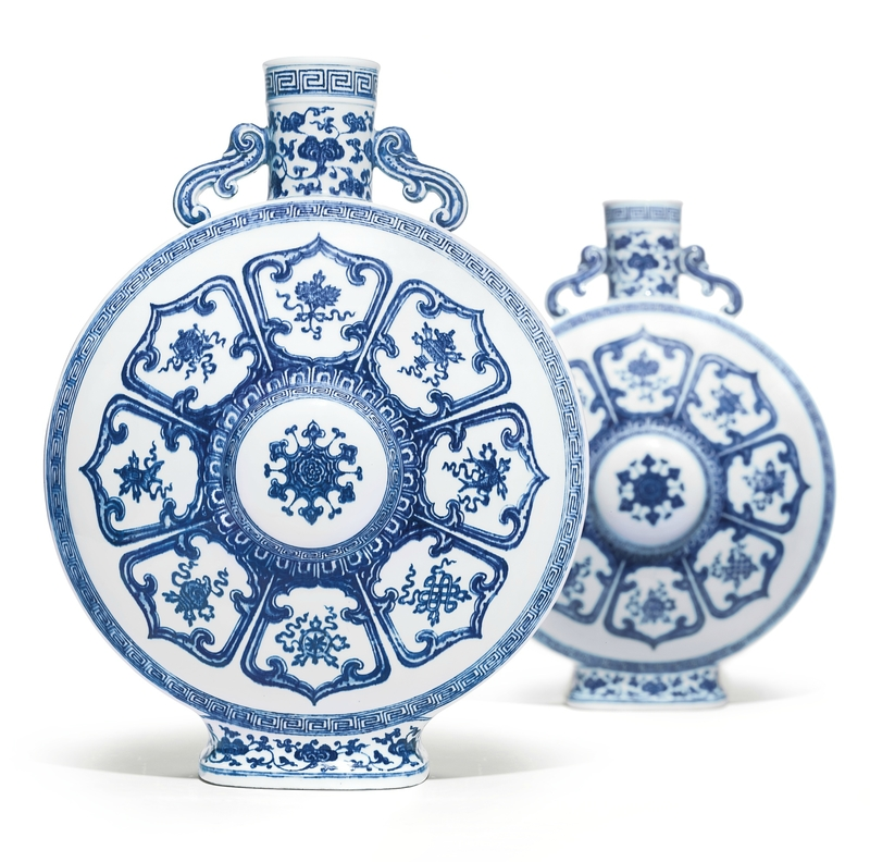 A rare pair of blue and white 'bajixiang' moonflasks, Qianlong seal marks and period