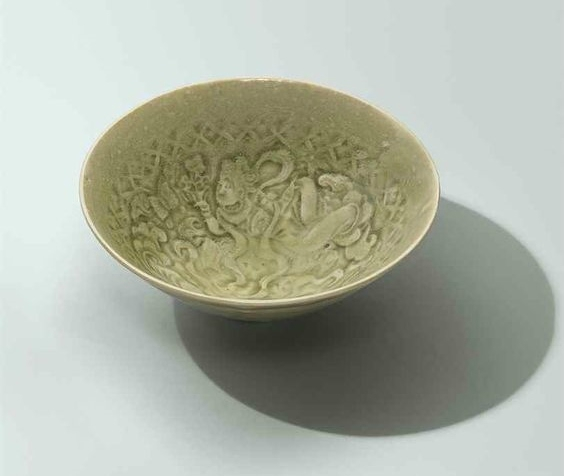 A moulded Yaozhou 'apsaras' bowl, Song dynasty (960-1279)