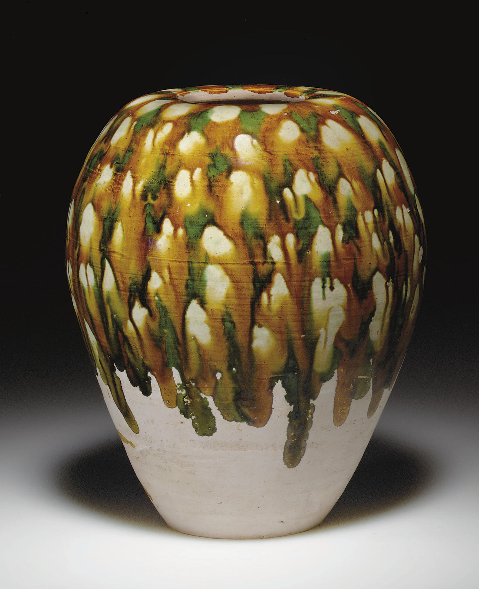 A rare sancai-glazed pottery tall ovoid jar,Tang dynasty (618-907)