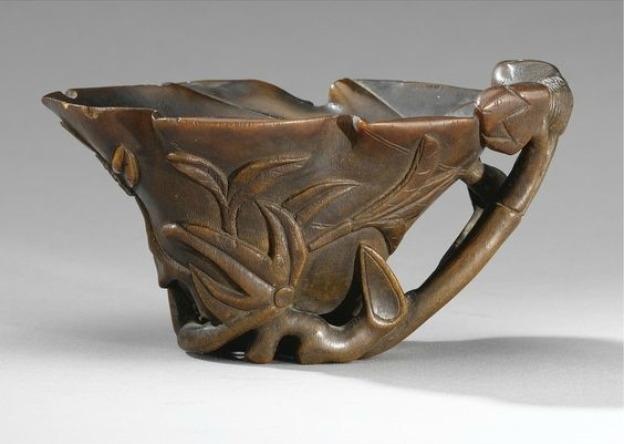 A Carved Rhinoceros Horn Libation Cup, Qing Dynasty, 17th-18th Century
