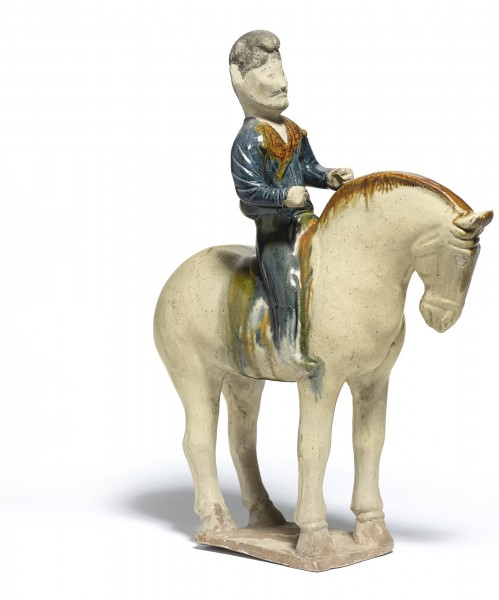 A rare sancai and blue-glazed pottery figure of an equestrian, Tang dynasty (618-907)