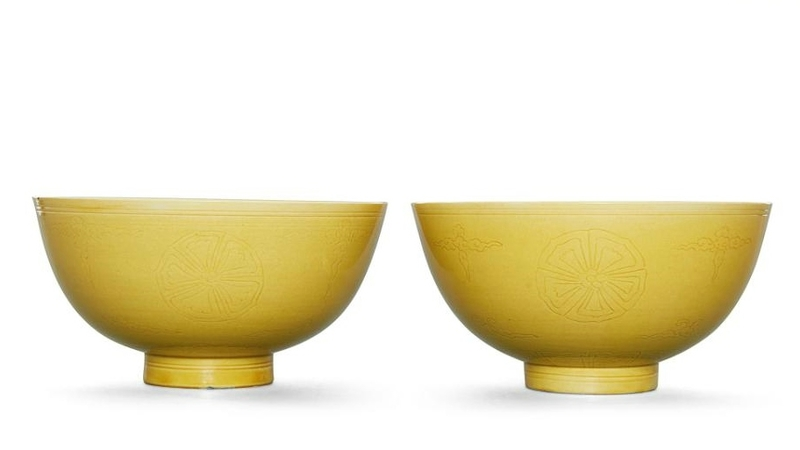 A pair of incised yellow-glazed 'floral' bowls, Kangxi marks and period (1662-1722)