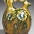 A rare small blue and sancai-glazed pottery flask, Liao dynasty (907-1125)