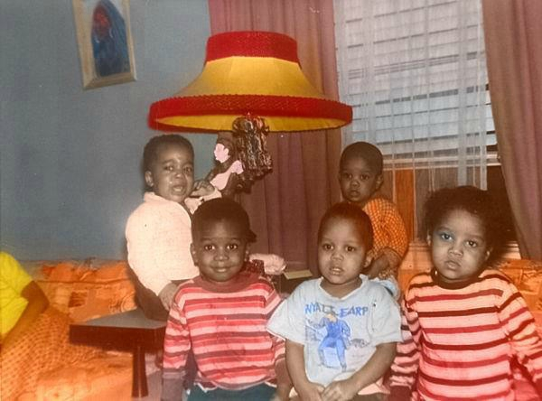 Michael in orange shirt near window, Latoya front-right, Marlon with white & blue shirt