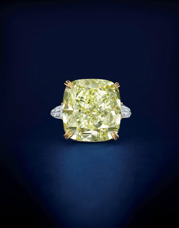 An impressive colored diamond and diamond ring