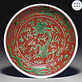 A green-glazed iron-red-ground 'dragon' dish, kangxi six-character mark in underglaze blue within a double circle and of the per