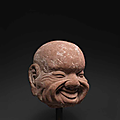 A rare sandstone head of a luohan, 14th-15th century