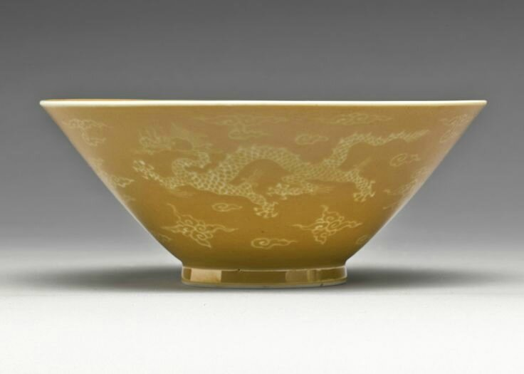 A rare and unusual cafe-au-lait ground white-slip decorated 'Dragon' bowl, Qing Dynasty, Kangxi Period