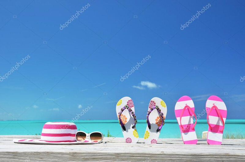 depositphotos_24585541-Hat-sunglasses-and-flip-flops-on-the-beach-of-Exuma-Bahamas