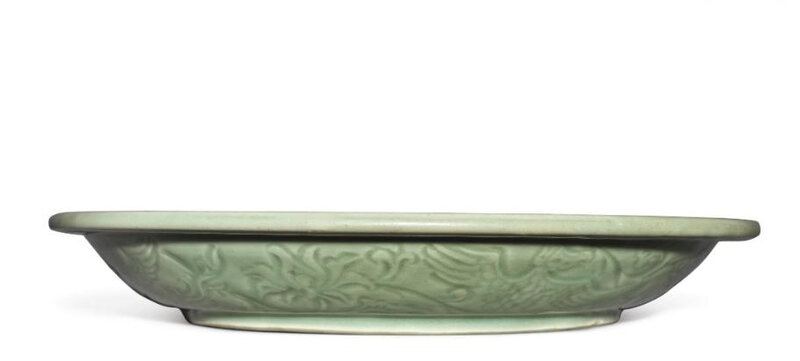 A large and rare carved 'Longquan' celadon-glazed 'phoenix and lotus' dish, Ming dynasty, 15th century