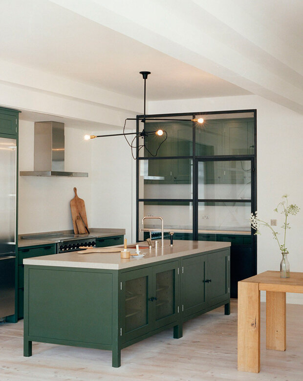 12-green-kitchens-long-island-with-dark-green-cabinets-and-cutting-boards-against-wall
