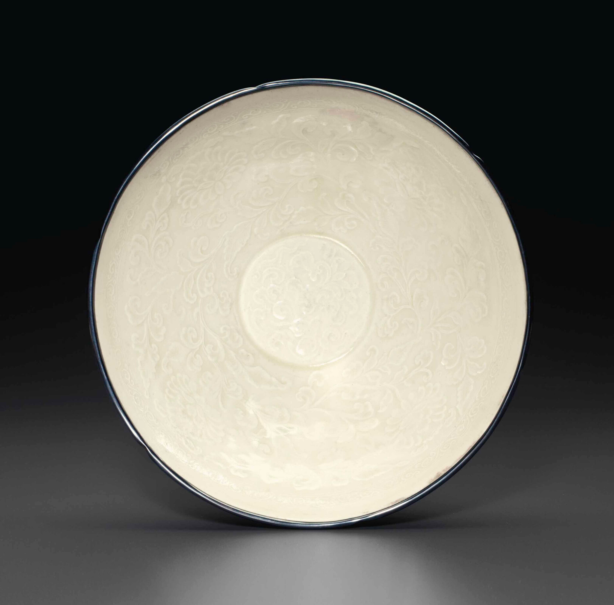 A molded Dingyao bowl, Northern Song-Jin Dynasty, 11th-12th century