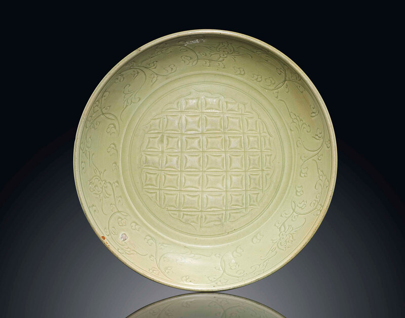 A largeLongquanceladon carved dish, Ming dynasty, late 14th-15th century