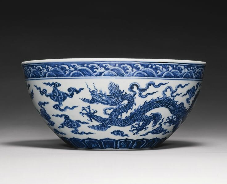 A rare and important blue and white 'Dragon' bowl (bo), Xuande mark and period 2