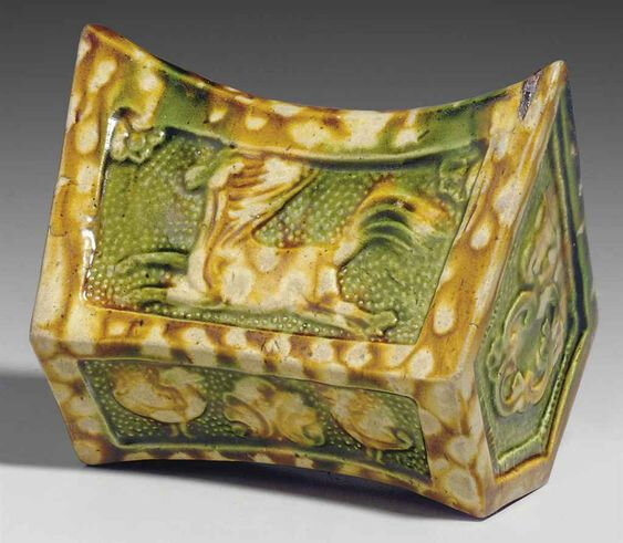 A rare small sancai-glazed pottery pillow, Tang dynasty (618-907)