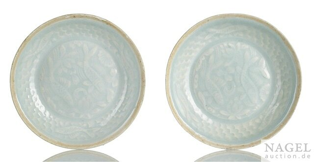 A pair of Qingbai moulded saucer dishes, Yuan dynasty