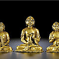 A set of three gilt-bronze daoist deities, 14th-15th century
