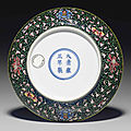 A rare yellow-enameled famille noire saucer dish, yongzheng six-character mark and of the period (1723-1735)