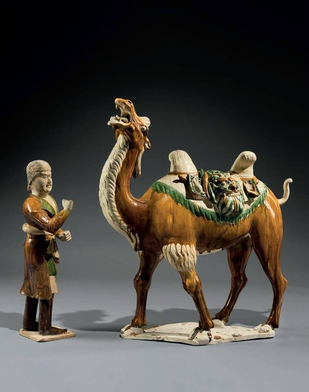 A magnificent sancai-glazed pottery figure of a Bactrian camel and a foreign groom, Tang dynasty (AD 618-907)