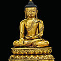 A rare and important gilt-bronze figure of buddha shakyamuni, tibet, early 15th century