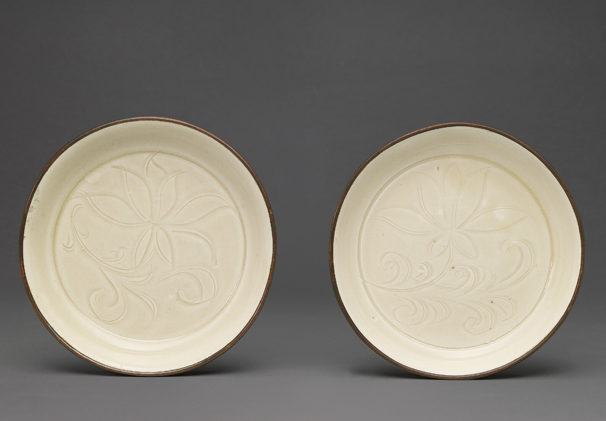 Two carved 'lotus' ding washers, Song dynasty (960-1279)