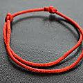 Bracelet en fil rouge du marabout compétent kpogaga