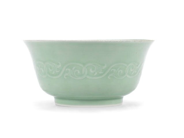 A carved celadon-glazed bowl, Yongzheng six-character mark and possibly of the period